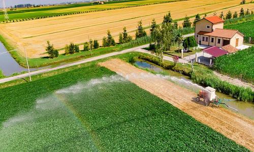 A device irrigating a farm.